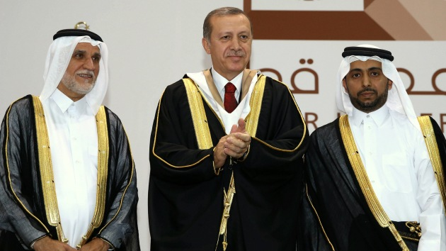Turkey's President Recep Tayyip Erdogan applauds after he received an honorary doctorate from Qatar University in Doha, Qatar, Wednesday, Dec. 2, 2015. Sharply raising the stakes in Moscow's spat with Ankara, Russia's top military brass on Wednesday accused Erdogan and his family of personally profiting from oil trade with Islamic State militants. The Turkish leader has denied Russian President Vladimir Putin's earlier claims of Turkey's involvement in oil trade with the IS, and has pledged to step down if Moscow proves its accusations.(AP Photo/Yasin Bulbul, Presidential Press Service, Pool)
